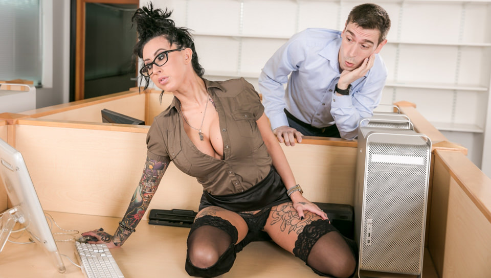 Lily is a tattooed bad ass office worker that just doesn't give a fuck. Patrick is a nerdy boss that tries to get her to get to work, but she has other things in mind. She teases her little bitch boy boss and seduces him with her giant tits.