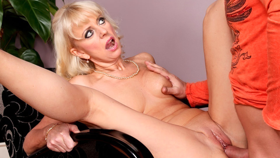Very hot blonde granny Merylin fucks with Tarzan